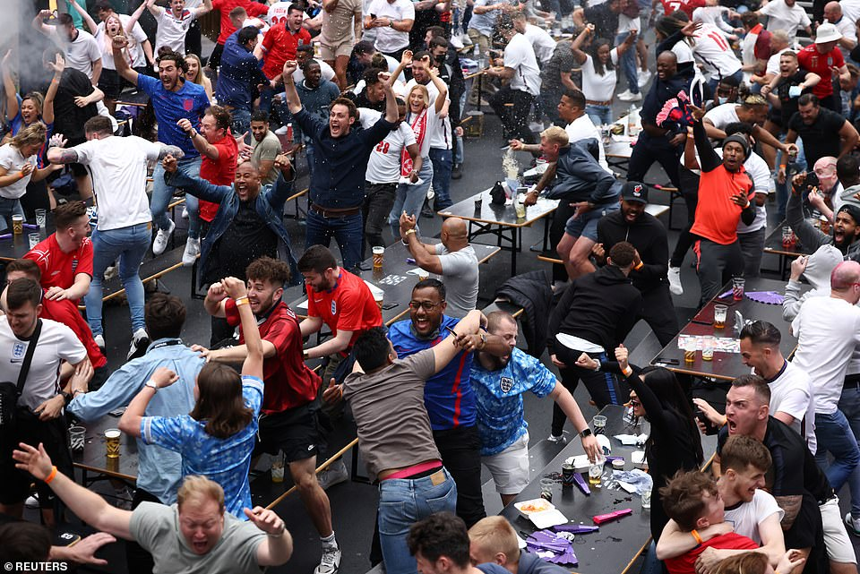 44829465-9737841-England_fan_celebrate_in_Boxpark_Croydon_after_England_s_Harry_K-a-128_1624993781467.jpg